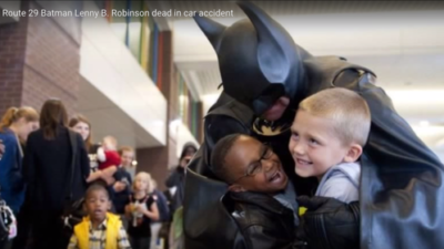 """Click photo to download. Caption: The late Leonard """"Lenny"""" Robinson would dress in a Batman costume and visit pediatric wards in the Baltimore and Washington, DC areas. Credit: YouTube screenshot."""
