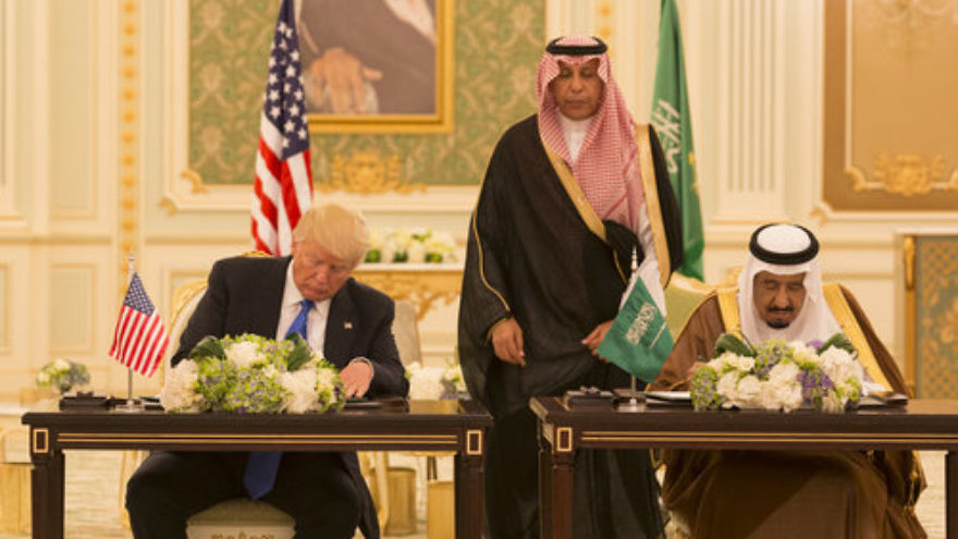 U.S. President Donald Trump and Saudi Arabia's King Salman sign a Joint Strategic Vision Statement for the United States and the Kingdom of Saudi Arabia at the Royal Court Palace in Riyadh, May 20, 2017. Credit: White House Photo/Shealah Craighead.