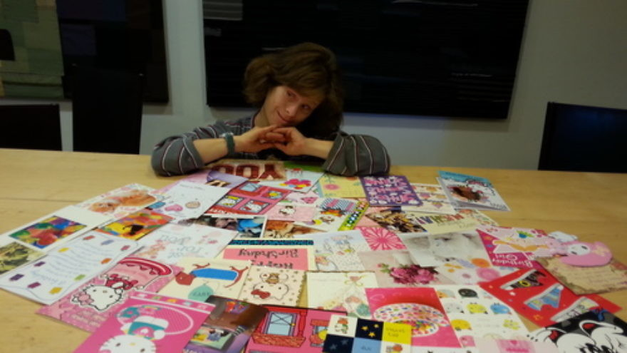 Click photo to download. Caption: Masha Roth with her birthday cards. Credit: Courtesy Roth family.