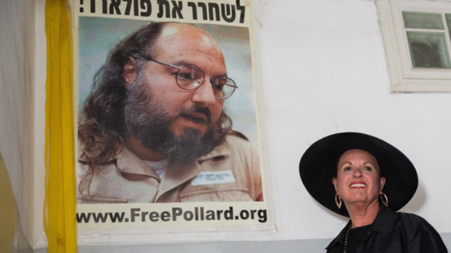 Esther Pollard walks past a poster of her husband, Jonathan Pollard, before speaking to reporters outside of her Jerusalem home on July 29, the day after it was announced that Jonathan, jailed for nearly 30 years over giving Israel classified information on America, will be released in November 2015. Credit: Flash90.