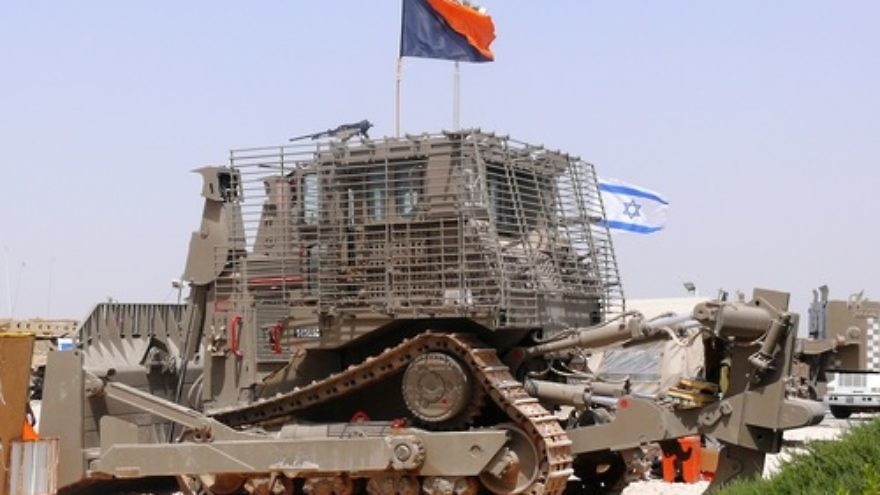 "An IDF Caterpillar D9 bulldozer. In calling for a boycott of Caterpillar—long a target of the anti-Israel BDS movement—Dalit Baum speaks of the bulldozers' use to ""raze Palestinian homes [and] construct the separation barrier,"" ignoring the fact that the demolished buildings were being used to shield attacks or belonged to terrorists who murdered innocent civilians, writes Robin Joshowitz. Credit: MathKnight via Wikimedia Commons."