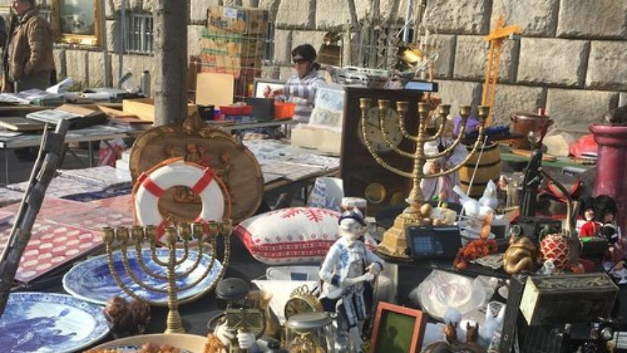 Two Hanukkah menorahs are pictured among other antiques at a flea market in Berlin. Credit: Orit Arfa.