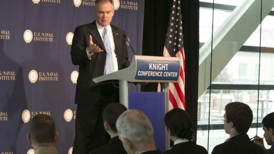 Click photo to download. Caption: U.S. Sen. Tim Kaine (D-Va.) gives a speech in December 2013. Credit: U.S. Naval Institute via Flickr.com