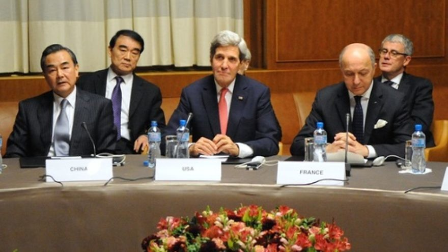 Click photo to download. Caption: U.S. Secretary of State John Kerry (front, center) sits between Chinese Foreign Minister Wang Yi (left) and French Foreign Minister Laurent Fabius (right) at the United Nations Headquarters after the P5+1 nations reached an interim nuclear deal with Iran in Geneva, Switzerland, on November 24, 2013. Credit: U.S. State Department.