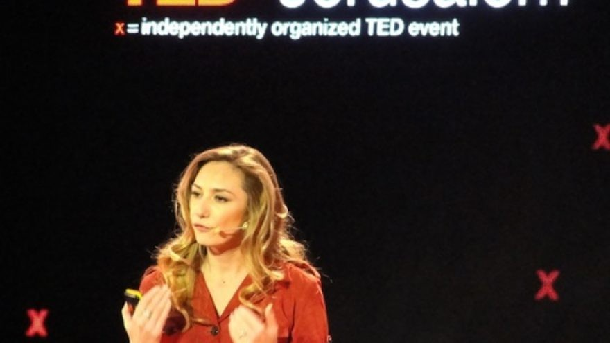 Click photo to download. Caption: Michal Ansky, a food journalist and television presenter, speaks at the Dec. 10 TEDx conference in Jerusalem. Credit: Judy Lash Balint.