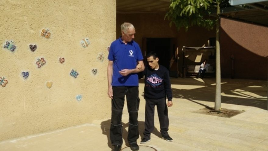 Click photo to download. Caption: Peter Von Brockhausen (left) and Elad Sair at the Aleh Negev-Nahalat Eran rehabilitation village in southern Israel. Credit: Courtesy Jewish National Fund.