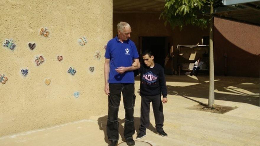Peter Von Brockhausen (left) and Elad Sair at the Aleh Negev-Nahalat Eran rehabilitation village in southern Israel. Credit: Courtesy Jewish National Fund.