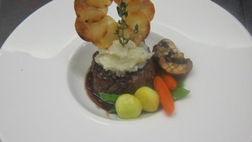 One of Chef Avram Wiseman's culinary creations: a filet of beef with Bordelaise, wasabi mashed potatoes, Maxim potatoes and mixed vegetables. Credit: Courtesy of Chef Avram Wiseman.