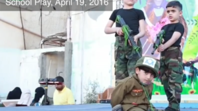A military-themed school play held in April 2016 at the UNRWA Nuseirat School in Gaza, in which students hold an Israeli hostage at gunpoint. Credit: Center for Near East Policy Research.