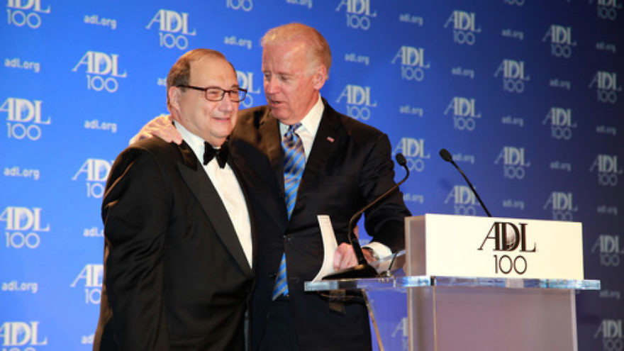 """U.S. Vice President Joe Biden sings """"Happy Birthday"""" to Abraham Foxman, the longtime national director of the Anti-Defamation League, at the ADL's Centennial Gala in April 2013 in Washington, D.C. Photo by David Karp."""