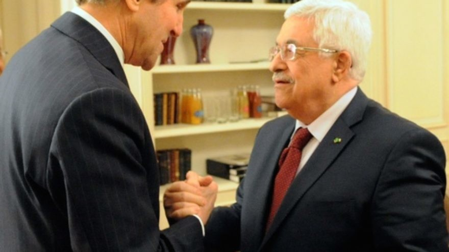 Click photo to download. Caption: U.S. Secretary of State John Kerry (left) and Palestinian Authority President Mahmoud Abbas shake hands before a meeting in Paris on Feb. 19, 2014. Credit: U.S. Department of State