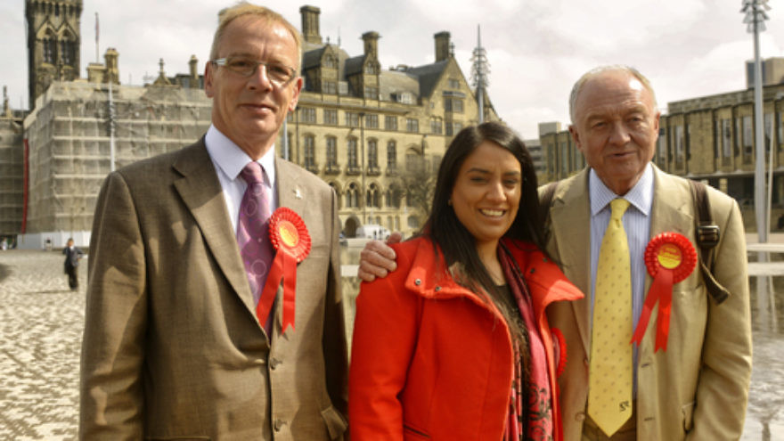 "Click photo to download. Caption: Pictured in the center is Naz Shah, who was suspended from the United Kingdom's Labour Party over a Facebook post in which she suggested the ""relocation"" of Israel. At right is Labour member and former London mayor Ken Livingstone, who was also suspended from the party for saying that Hitler was a Zionist. Credit: Wikimedia Commons."