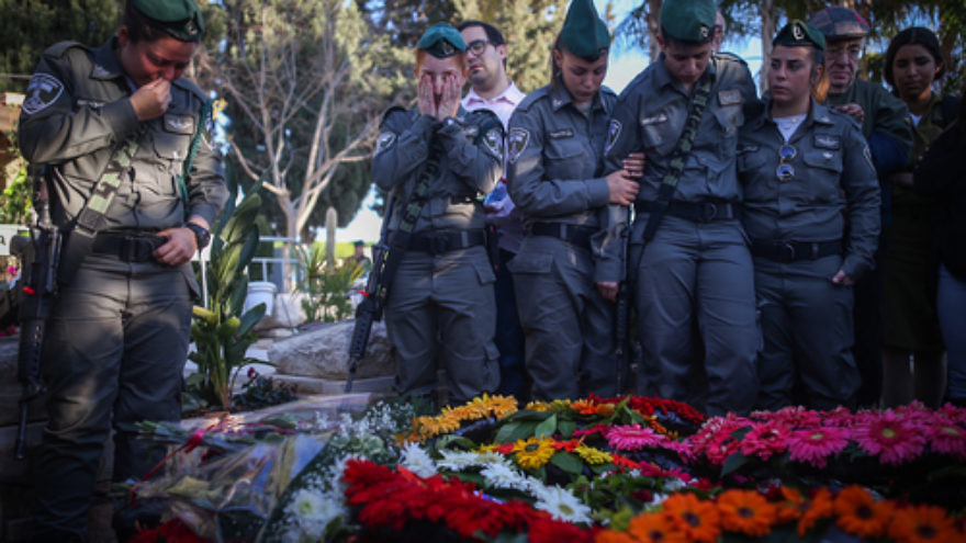 Click photo to download. Caption: Friends and relatives attend the funeral of slain Israeli Border Police officer Hadar Cohen, 19, at the cemetery in Yehud in central Israel on Feb. 4. Credit: Yonatan Sindel/Flash90.