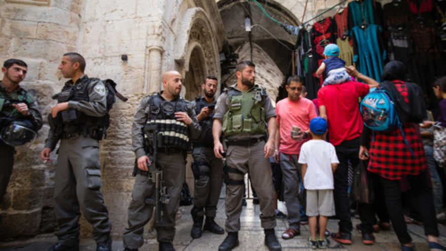 Click photo to download. Caption: On April 24, Israeli police officers guard an entrance to Jerusalem's Temple Mount during the Passover holiday, when an increased number of Jews visit the holy site. Credit: Corinna Kern/Flash90.