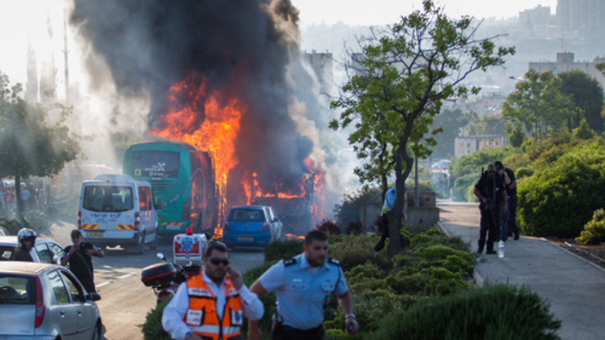 Click photo to download. Caption: The scene of the bus bombing on Moshe Baram Street in Jerusalem on April 18, 2016. Credit: Nati Shohat/Flash90.