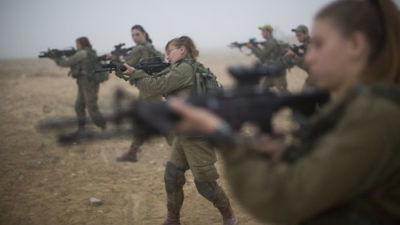 Soldiers of the IDF's Bardales Battalion prepare for urban-warfare training on a foggy morning in southern Israel July 13, 2016. Fifty-percent of the soldiers in the Bardales Battalion, an infantry combat unit, are women. Credit: Hadas Parush/Flash90.