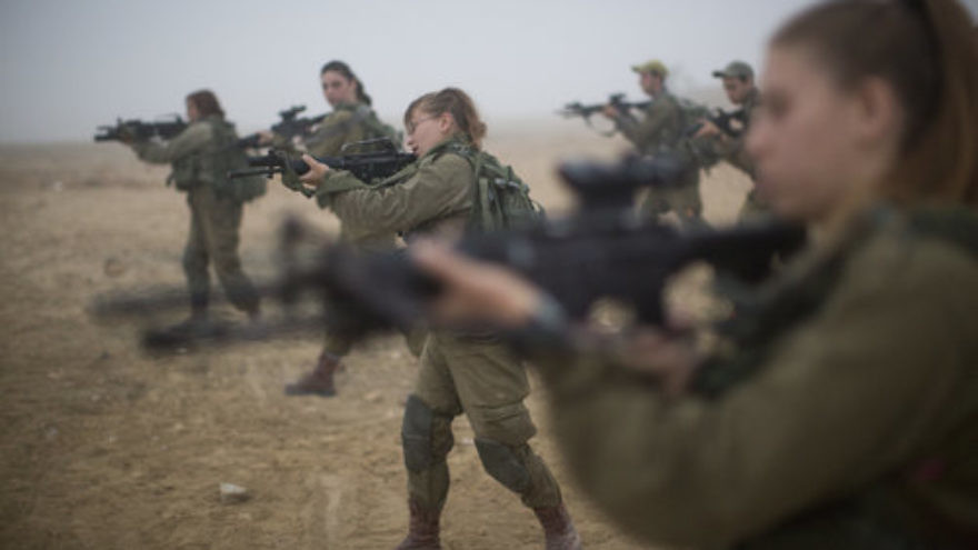 Soldiers of the IDF's Bardales Battalion prepare for urban warfare training on a foggy morning in southern Israel July 13, 2016. Fifty-percent of the soldiers in the Bardales Battalion, an infantry combat unit, are women. Credit: Hadas Parush/Flash90.