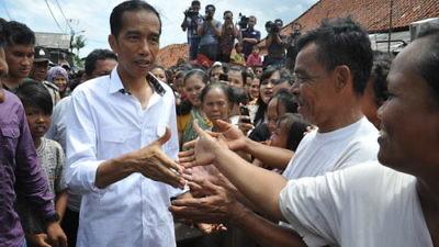 Indonesian President Joko Widodo (left) visits the country's capital of Jakarta. Credit: Jokowi Blusukan via Wikimedia Commons.