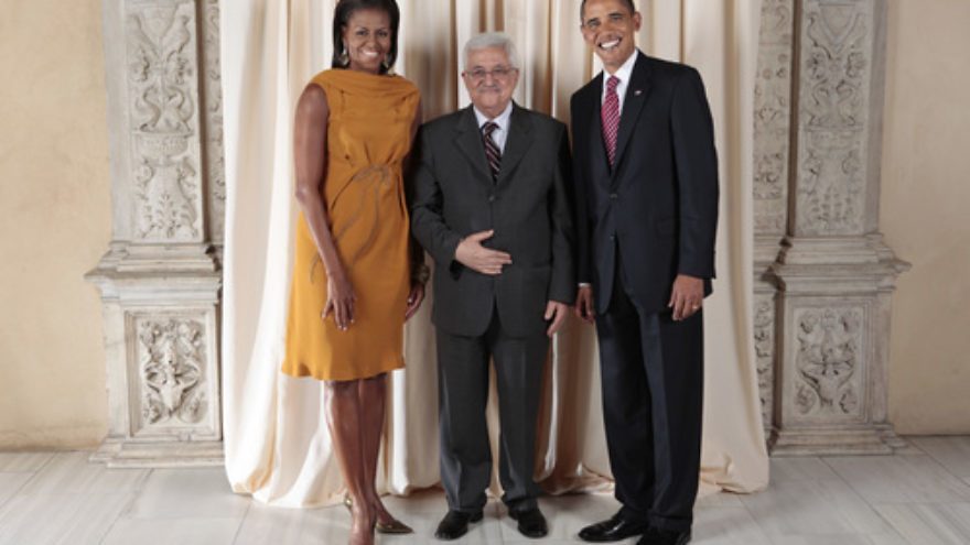 From left to right, First Lady Michelle Obama, U.S. President Barack Obama and Palestinian Authority leader Mahmoud Abbas. Columnist Stephen M. Flatow contrasts President Obama's reaction to the Bill Ayers controversy with how Abbas's government recently honored three Arab terrorists. Credit: White House photo by Lawrence Jackson.