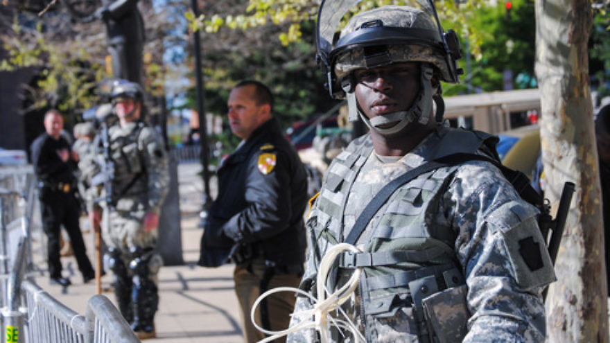 Click photo to download. Caption: A Maryland National Guard soldier keeps watch in front of Baltimore City Hall on April 28 to help deter violence in that area. Credit: Staff Sgt. Ron Lee, 29th Mobile Public Affairs Detachment.