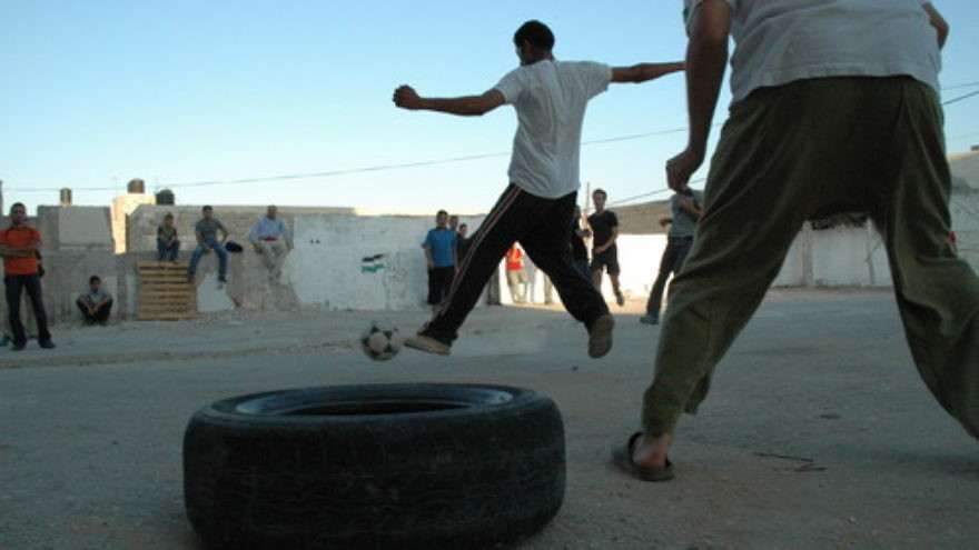 Palestinians play soccer in the West Bank. Credit: Justin McIntosh via Wikimedia Commons.