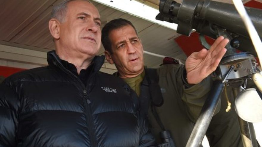 Israeli Prime Minister Benjamin Netanyahu (left) with Aviv Kochavi, head of the IDF Northern Command, during a visit to a military outpost on Mount Hermon in the Golan Heights, overlooking the Israel-Syria border, in February 2015. Credit: Effi Sharir/POOL/Flash90.