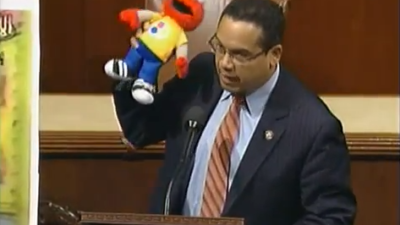 Click photo to download. Caption: Holding Elmo, Congressman Keith Ellison makes the case against defunding Palestinian Sesame Street. Credit: YouTube.