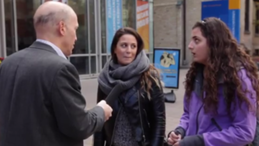 Click photo to download. Caption: Jerry Amernic (left) interviews Toronto students about the Holocaust and World War II. What the students didn't know would, literally, fill a book. Credit: YouTube screenshot.