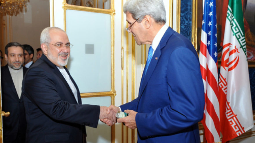 U.S. Secretary of State John Kerry with Iranian Foreign Minister Mohammad Javad Zarif as he arrives at a hotel in Vienna, Austria, on July 14, 2014, for a day of meetings about Iran's nuclear program. Credit: U.S. State Department.