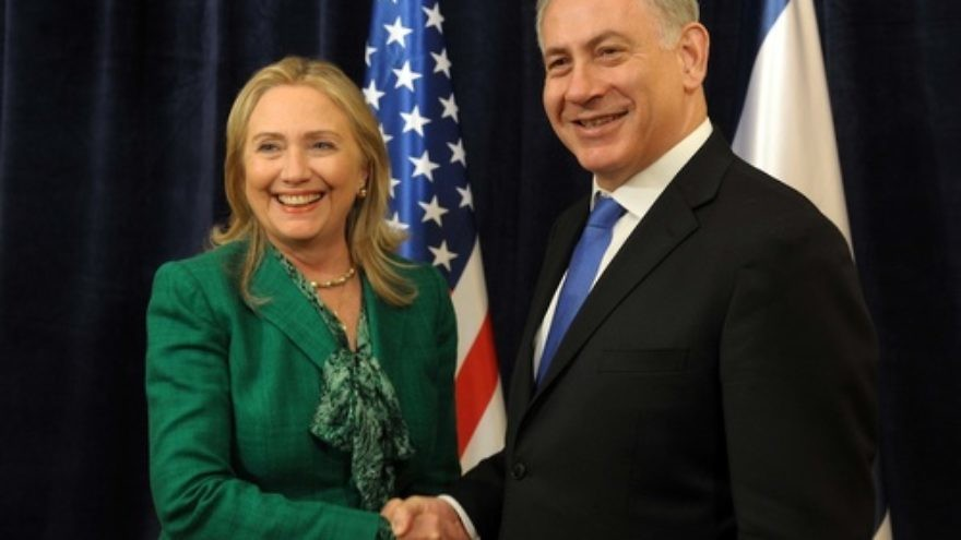 U.S. Secretary of State Hillary Clinton laughs as she meets with Israeli Prime Minister Benjamin Netanyahu (R) during an offsite bilateral meeting as part of the 67th United Nations General Assembly in New York, September 27, 2012. Credit: Avi Ohayon/GPO/Flash90.