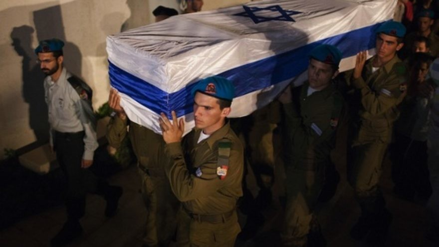 Click photo to download. Caption: Israeli soldiers carry the coffin of Netanel Yahalomi during his funeral in the Israeli city of Modiin, early Sunday, September 23, 2012. Yahalomi was killed September 21 in a shootout between Islamic terrorists and Israeli troops along Israel's southern border with Egypt. The Israeli troops returned fire, killing the terrorists. Credit: Yonatan Sindel/Flash90.