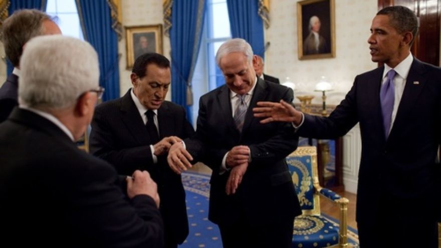 Click photo to download. Caption: President Barack Obama (far right) with Israeli Prime Minister Benjamin Netanyahu and then Egyptian President Hosni Mubarak—both checking their watches—in September 2010 at the White House. Netanyahu now says time is of the essence in solving the Iranian nuclear issue, while the U.S. says it will not set deadlines for Iran. Credit: White House.