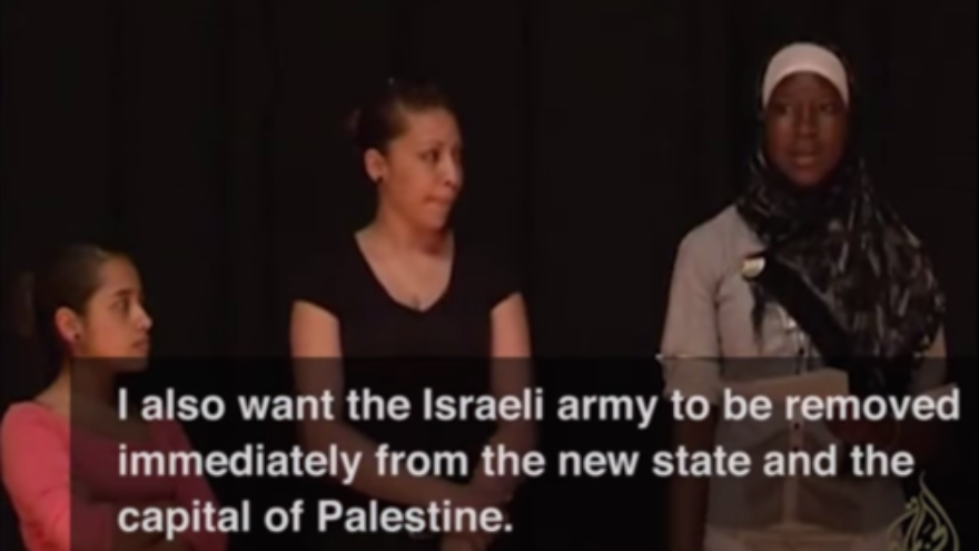 "Click photo to download. Caption: During a role play exercise, a participant of Axis of Hope's ""Whose Jerusalem?"" workshop expresses the desire for the Israeli army ""to be removed immediately from the new [Palestinian] state and the capital of Palestine."" Credit: YouTube."