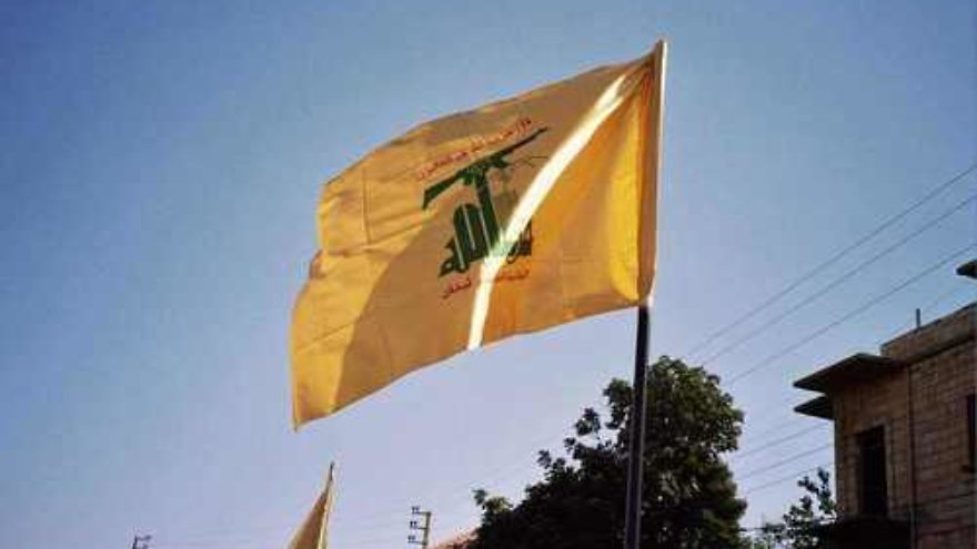 "Click photo to download. Caption: The flag of the Hezbollah terrorist group, which Israeli Prime Minister Benjamin Netanyahu described as ""Iran's chief terrorist proxy"" in his speech to Congress on Tuesday. Credit: Wikimedia Commons."