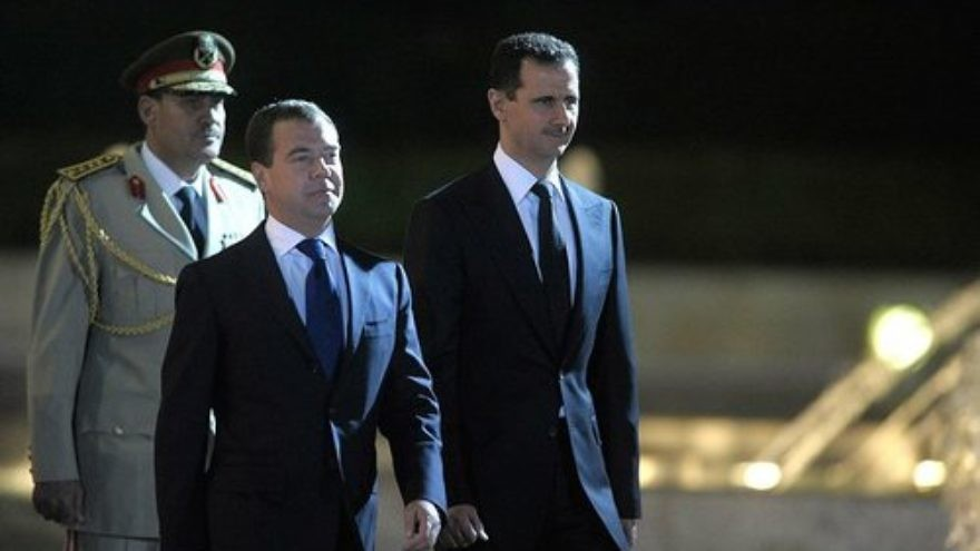 Syrian President Bashar Assad (right) with Russian Prime Minister Dmitriy Medvedev. Russia has vested interests in what happens as part of the current quagmire in Syria. Credit: Presidential Press and Information Office.