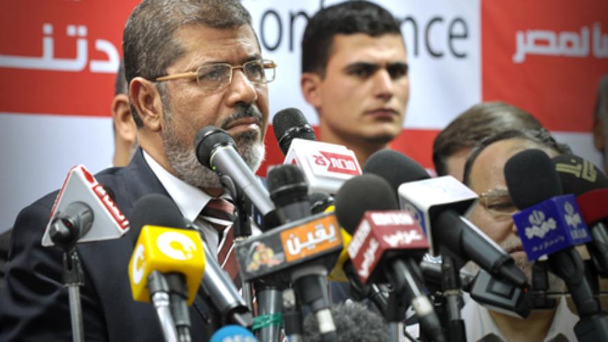 Click photo to download. Caption: Egyptian President Mohammed Morsi at a press conference. Credit: Jonathan Rashad.