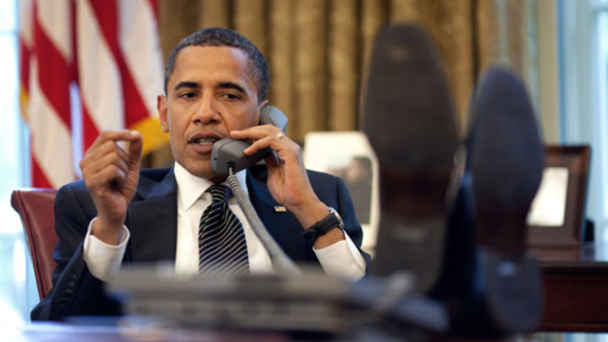 Click photo to download. Caption: President Barack Obama, with his feet on his desk, speaks on the phone to Israeli Prime Minister Benjamin Netanyahu on June 8, 2009. Credit: Pete Souza/White House.