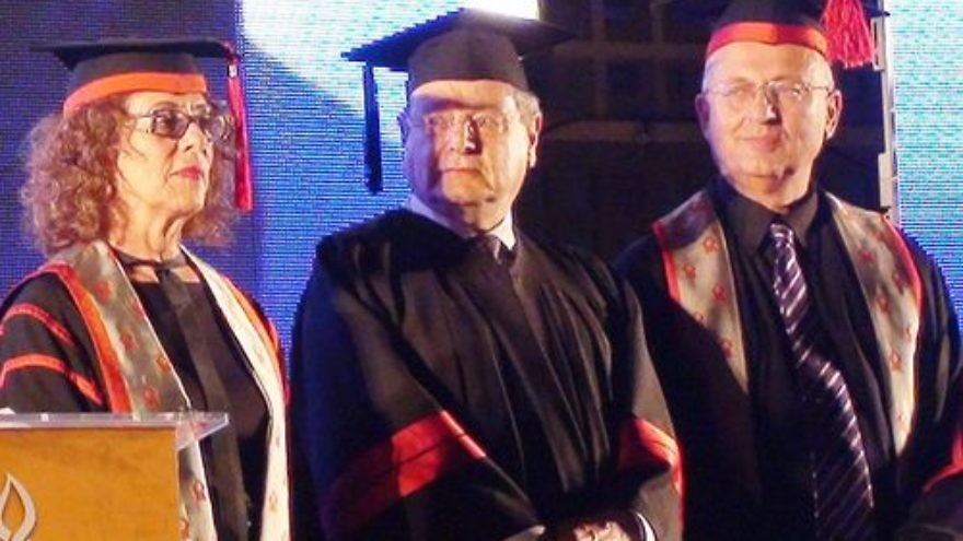 Click photo to download. Caption: Sir Martin Gilbert (center) is awarded an honorary doctorate at Ben Guion University in Be'er Sheva, Israel, in May 2011. Credit: Wikimedia Commons.