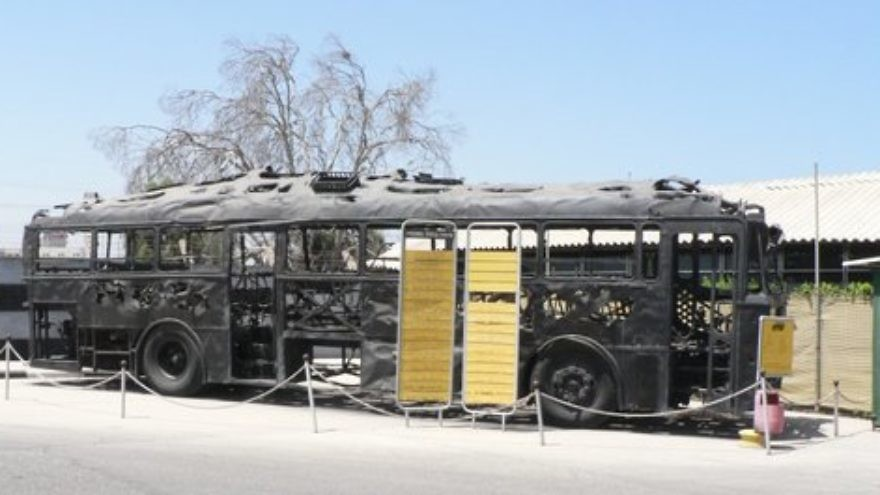 Click photo to download. Caption: The charred remains of an Israeli bus attacked in the 1978 Coastal Road massacre, whose Palestinian terrorist perpetrators included Dalal Mughrabi. Credit: MathKnight via Wikimedia Commons.