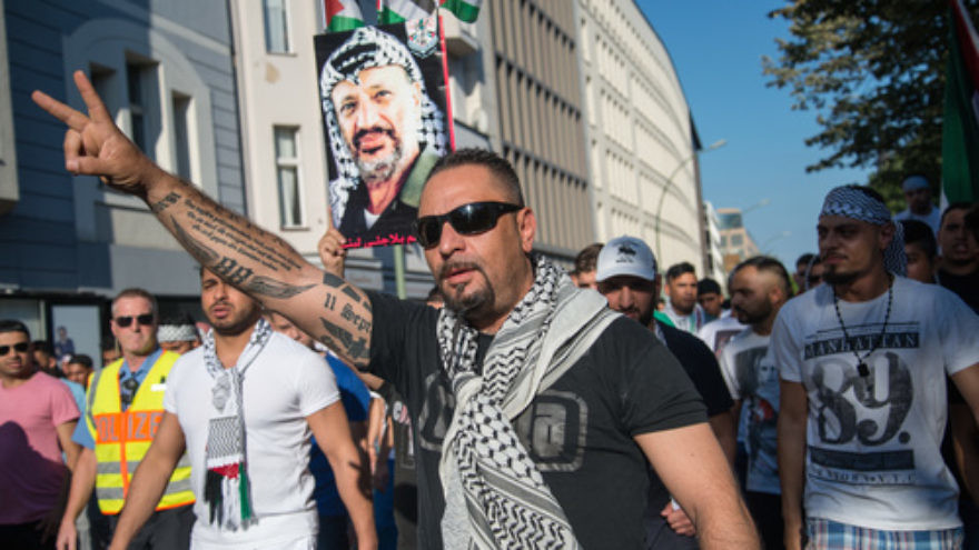"Demonstrators in Berlin carry a picture of Yasser Arafat in July 2014, protesting against the Israel Defense Forces' ""Operation Protective Edge"" in Gaza. Credit: Boris Niehaus via Wikimedia Commons."