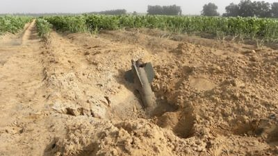 A Gaza rocket that fell in an Eshkol Regional Council field in Israel during the ongoing conflict. Credit: Ronit Minaker.