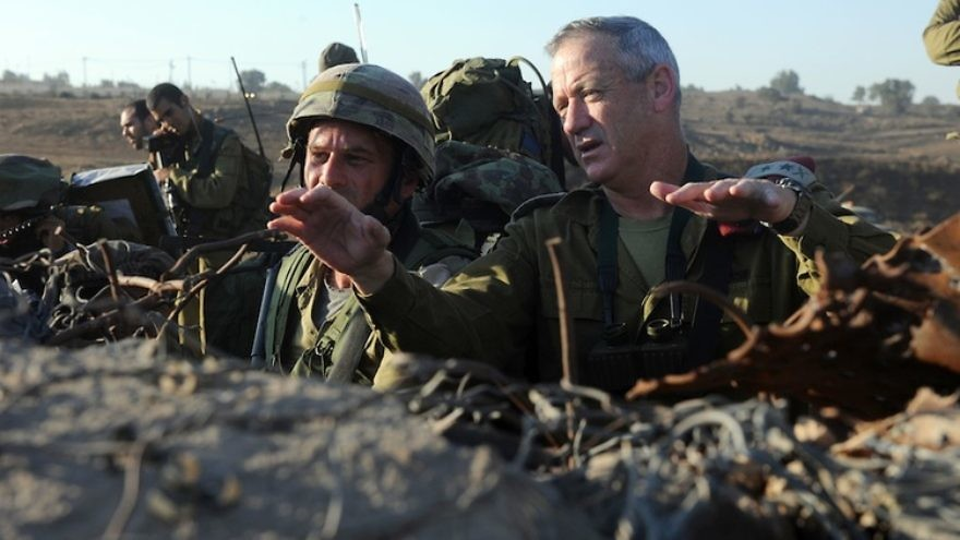 """Israel Defense Forces Chief of Staff Lt. Gen. Benny Gantz (right) in action during a live-fire exercise for Israeli army battalion commanders taking place in the Golan Heights, Sept. 4, 2012. Syrian tanks entered the Golan Heights demilitarized zone, raising concerns that the ongoing civil war could spill over into Israel. After Syrian tanks entered the Golan's demilitarized zone Nov. 3, Gantz told IDF soldiers the Syrian civil war """"could turn into our affair"""" in Israel. Credit: Shay Wagner/IDF/Flash90."""