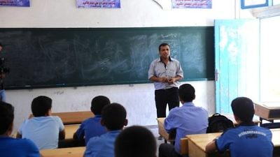In September 2011, a teacher leads one of the first classes of the new academic year at a Gaza-based school supported by the United Nations Relief and Works Agency for Palestine Refugees in the Near East (UNRWA). Credit: U.N. Photo/Shareef Sarhan.