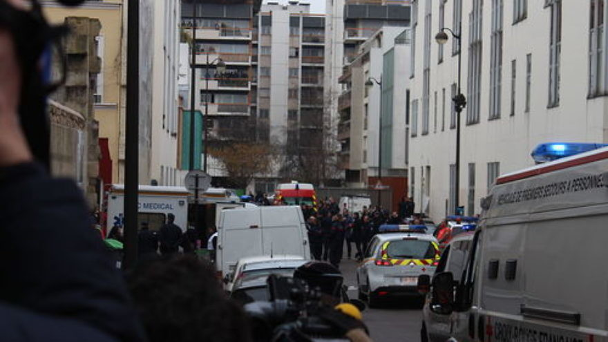 "The scene of the Jan. 7, 2015 Islamist terror attack on the offices of the ""Charlie Hebdo"" satirical newspaper in Paris. Credit: Thierry Caro via Wikimedia Commons."
