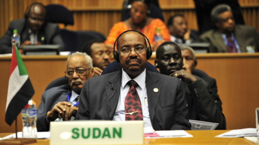 Click photo to download. Caption: Omar Hassan al-Bashir (front), the president of Sudan, listens to a speech during the 20th session of The New Partnership for Africa's Development in Addis Ababa, Ethiopia, in January 2009. Credit: U.S. Navy photo by Mass Communication Specialist 2nd Class Jesse B. Awalt/Released.