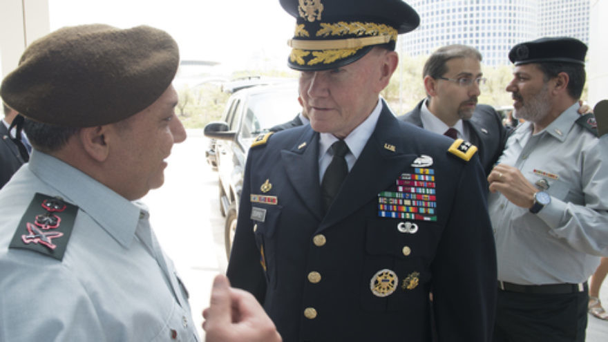Click photo to download. Caption: Israel Defense Forces (IDF) Chief of Staff Lt. Gen. Gadi Eizenkot (far left) speaks with Gen. Martin E. Dempsey (center), chairman of the U.S. Joint Chiefs of Staff, in Tel Aviv on June 9, 2015. Bolstering Israeli-American defense ties is among the principles mentioned in a new document released by Eizenkot on Aug. 13. The release marked the first time in 60 years that the IDF has made its official strategy publicly available. Credit: DOD photo by D. Myles Cullen/Released.
