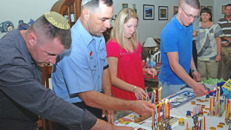 Click photo to download. Caption: U.S. Navy personnel light Hanukkah candles on Dec. 28, 2008, in Guantanamo Bay, Cuba. Credit: U.S. Navy photo by Mass Communication Specialist 1st Class Richard M. Wolff.