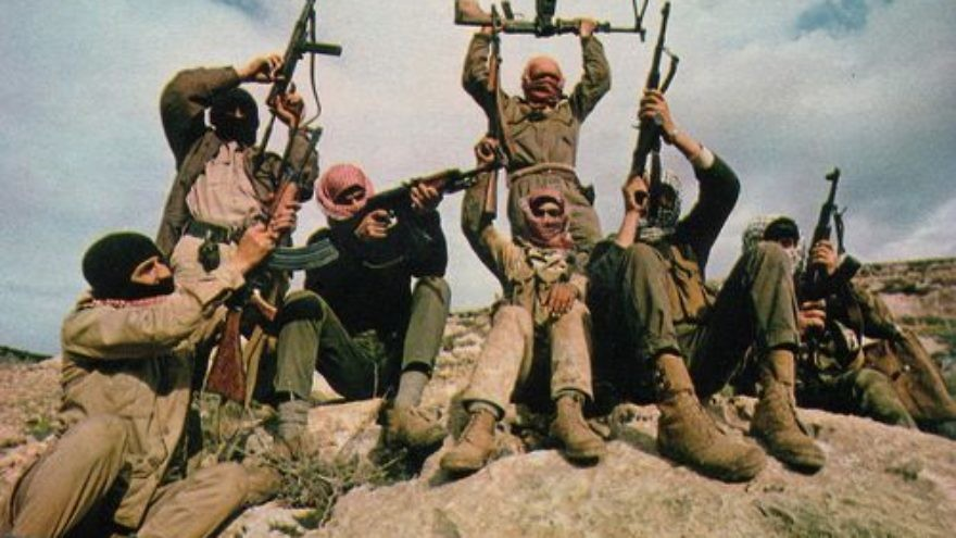 In 1969, members of the Popular Front for the Liberation of Palestine (PFLP) terror group are pictured flaunting their weapons in the mountains east of the Jordan River. Eclipsed in recent decades by the other Palestinian factions of Fatah and Hamas, the PFLP returned to the scene with a vengeance on Nov. 18, 2014, at a synagogue in the Har Nof section of Jerusalem. Four male worshippers and a Druze police officer were killed in the especially bloody terror attack. Credit: Thomas R. Koeniges via Wikimedia Commons.