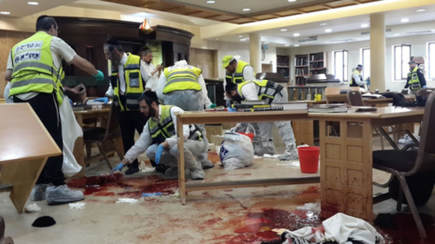 Click photo to download. Caption: Israeli ZAKA first responders at the site where two Palestinian terrorists on Tuesday entered the Kehilat Yaakov synagogue in the Jewish neighborhood of Har Nof, Jerusalem, with pistols and axes, and began attacking Jewish worshippers. Four Jewish worshippers were killed in the attack. Credit: ZAKA Spokesperson.