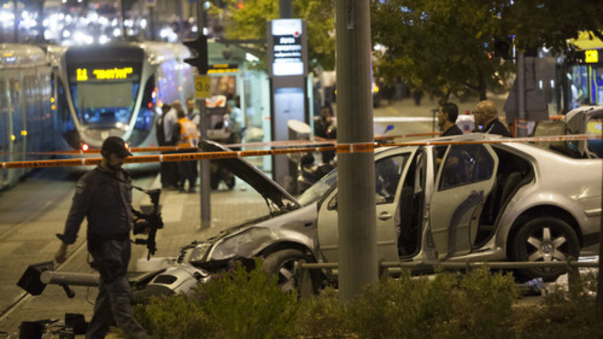 Click photo to download. Caption: The scene where a car crashed into Jerusalem's Ammunition Hill light rail station in a Palestinian terrorist attack on October 22, 2014. Credit: Flash90.